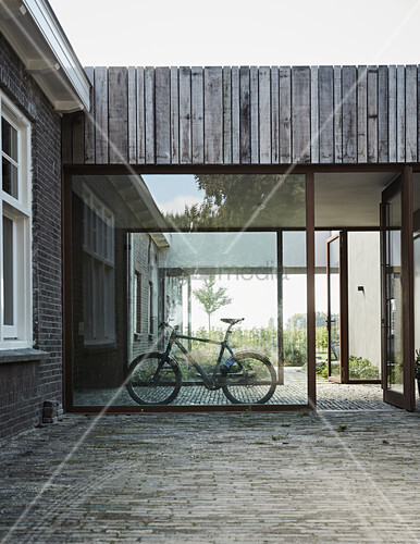 Bicycle in glazed passage