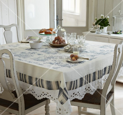 Toile de jouy tablecloth on dining table in traditional ambiance