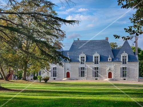 Château des Grotteaux in grounds under blue sky