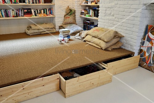 Drawers below platform and cushions made from old hessian sacks