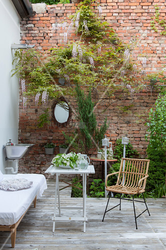 Inviting seating area on terrace with exposed brick wall