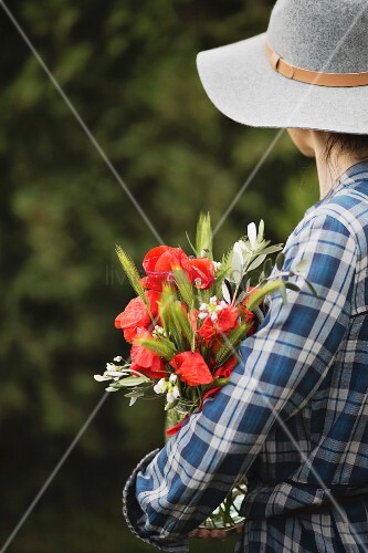 Woman holding a vase of flowers