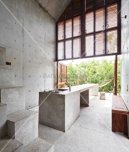 Modern architect-designed house made from wood and concrete with open façade