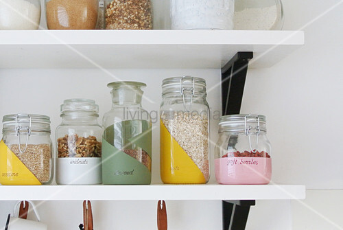 Hand-painted storage jars on shelf