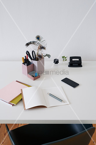 Desk tidy hand made from tetra-pack, notebook and utensils on desk