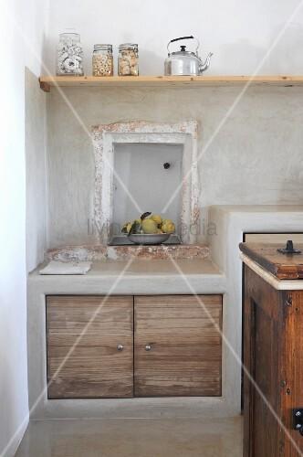 Niche above kitchen base unit in traditional, Mediterranean-style kitchen