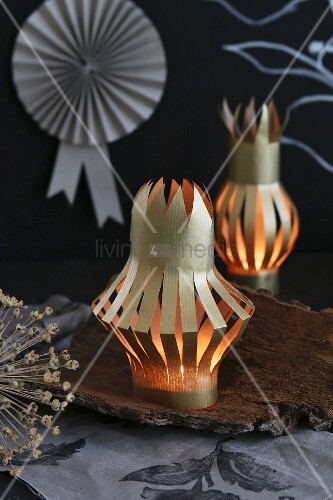 Concertina lanterns hand-crafted from gold paper decorating table