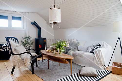 Attic living room with monochrome colour scheme