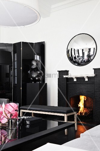 Open fireplace in elegant black and white living room