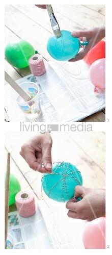 Weihnachtskugel basteln: rot-weisser Kordel über eingekleisterten Luftballon wickeln