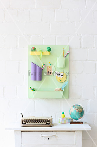Organiser made from recycled containers in pastel shades