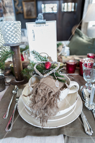 Christmas table lavishly set with many vintage-style decorations