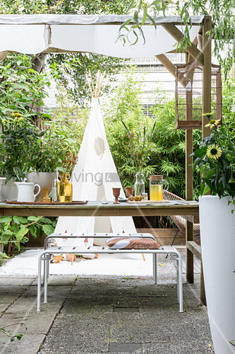 Set garden table on roofed terrace