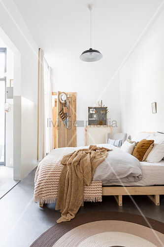 Bright bedroom in shades of white and brown