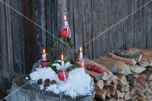 Pyramid Advent arrangement made from apples and box twigs