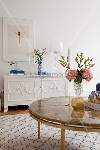 Vase of flowers on coffee table in elegant living room