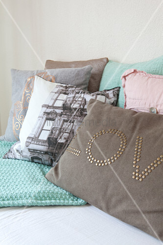 Various cushions with printed and appliqué motifs