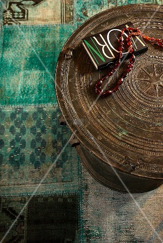 Necklace and book on ethnic table