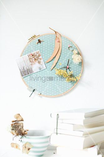 Polka-dot fabric in embroidery frame used as pinboard