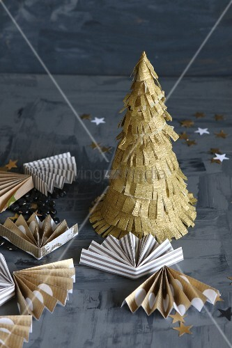Small hand-made paper Christmas tree and fans