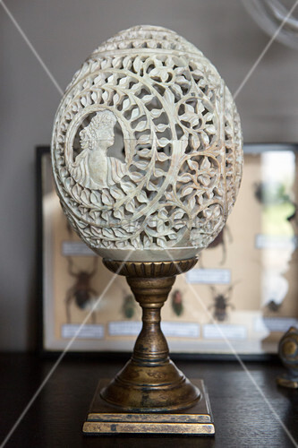 Engraved ostrich egg on metal stand