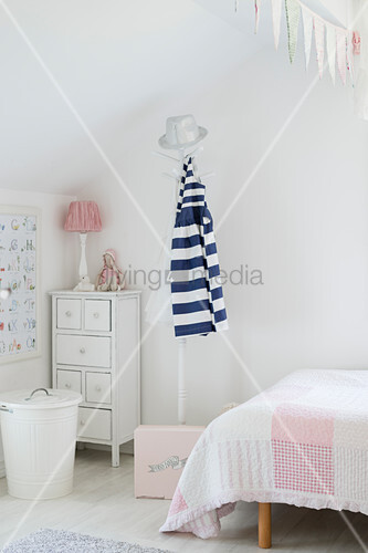 Coat stand and chest of drawers in child's bedroom