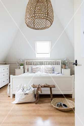 Attic bedroom in white and beige