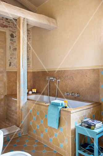 Bright blue accents in Mediterranean bathroom