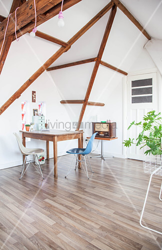 Table and classic chairs in attic room