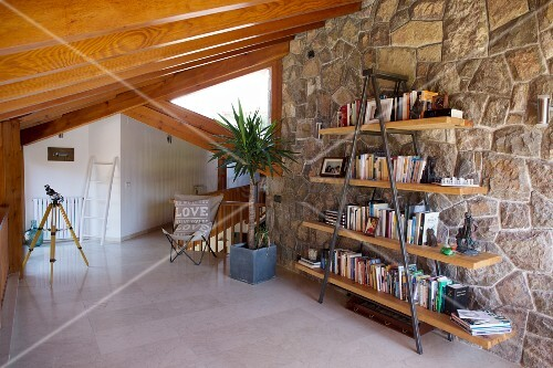 Steel and wooden shelves against stone wall