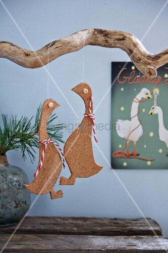 Cork geese hung from gnarled branch