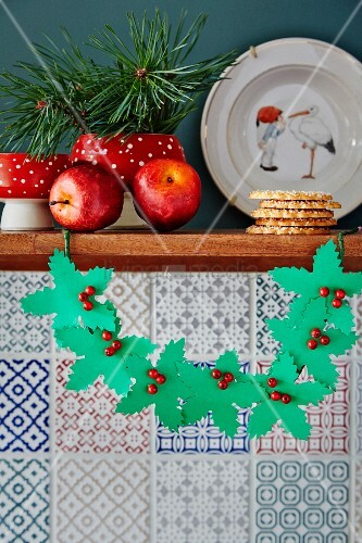 Paper holly garland with bead berries