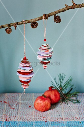 Baubles made from paper circles and beads hung from larch branch