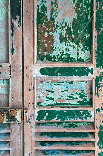 Vintage wooden door with peeling paint