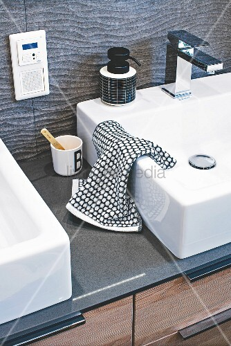 A square washbasin set into a quartz washstand