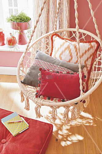 Decorative cushions on a swing chair in the living room