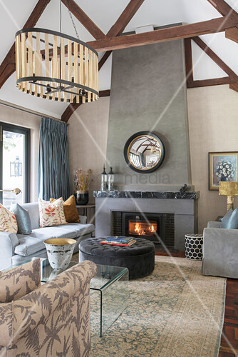 Beige and taupe wall in living room with fireplace and wood-beamed ceiling