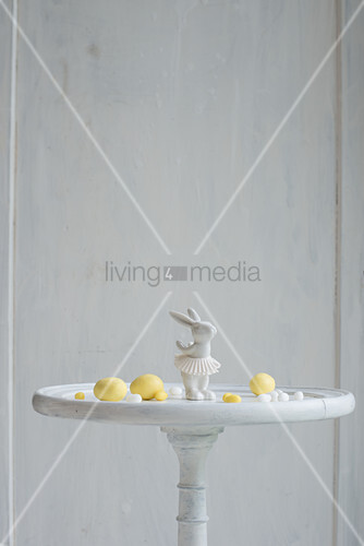 Easter bunny ornament and marzipan eggs on white table