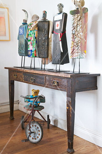 Artistic wooden figures on old table cut in half
