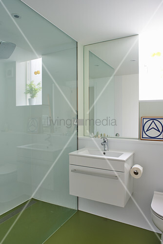 Clear lines and green floor in modern bathroom