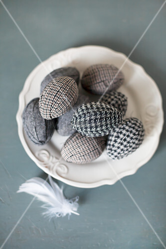 Easter eggs wrapped in fabric on plate
