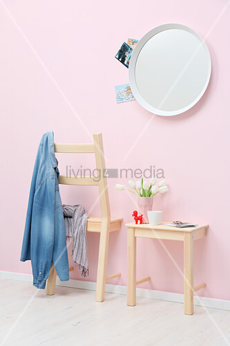 Coat rack and shelf made from halved chair against pink wall