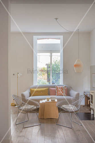 Sofa, nest of tables and classic chairs in living room
