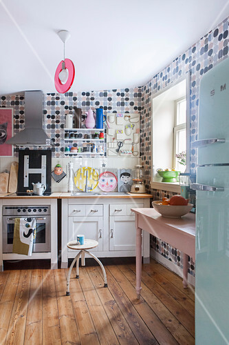 Retro polka-dot wallpaper in eclectic kitchen