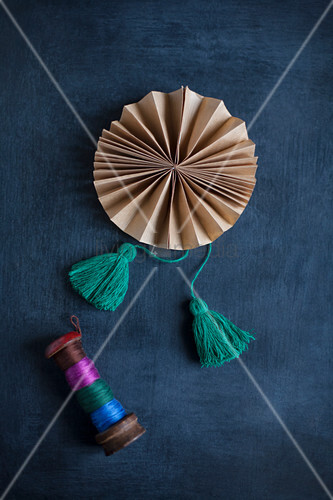 Hand-made paper rosette with tassels