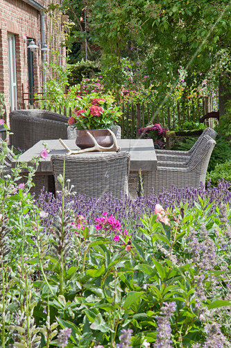 Outdoor furniture on terrace of converted stable
