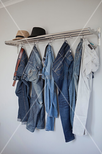 Jeans hung from coat rack