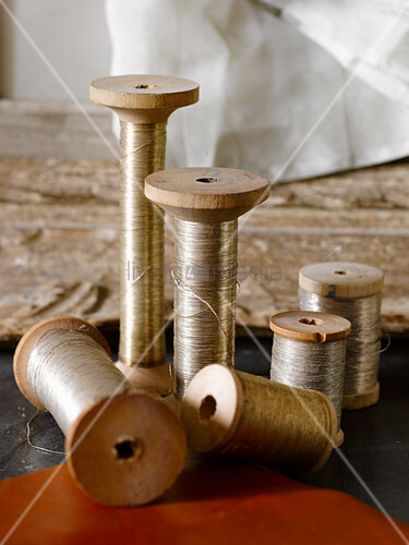 Silver thread on old wooden spools