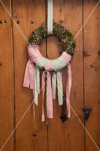 Gypsophila wreath tied with pink and green ribbons