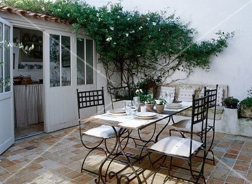 Set table on Mediterranean terrace in summer